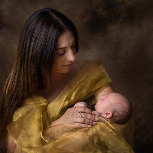 mother cradling newborn baby
