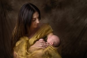 newborn portrait - mother cradling baby