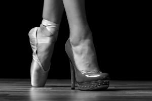 one foot in high heels the other in a ballet shot