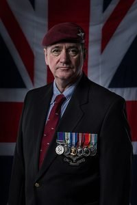 heirloom portrait - ex-serviceman wearing his medals in front of the Union Jack