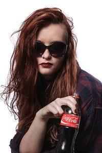 model portfolio shoot - woman holding a soft drink