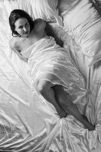 young lady wrapped in a white silk sheet