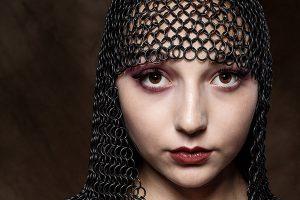 cinematic portrait - headshot of female wearing chain mail headdress